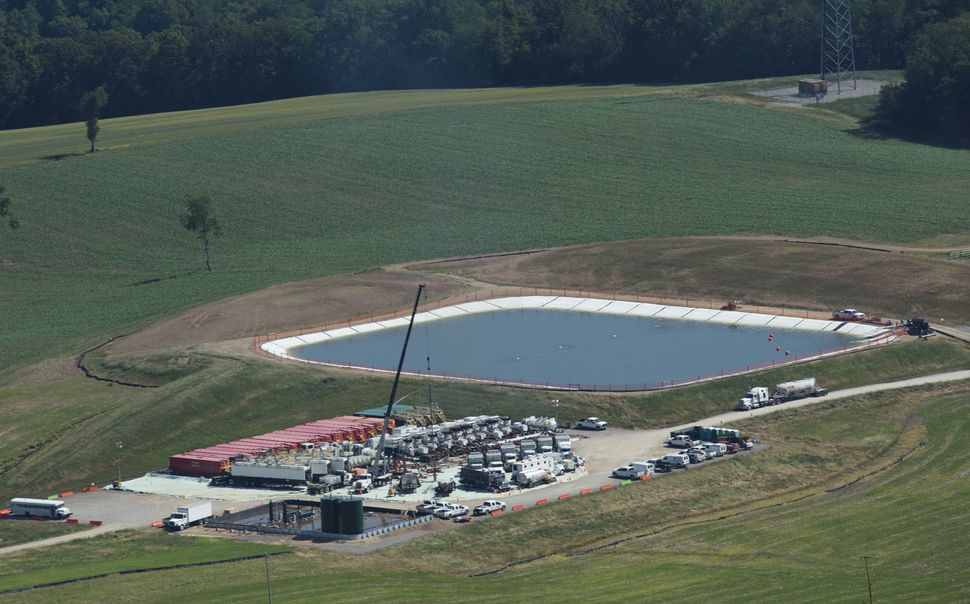 A pit containing fresh water or fresh water with chemicals sits next to a drill site in Butler County, Penn.