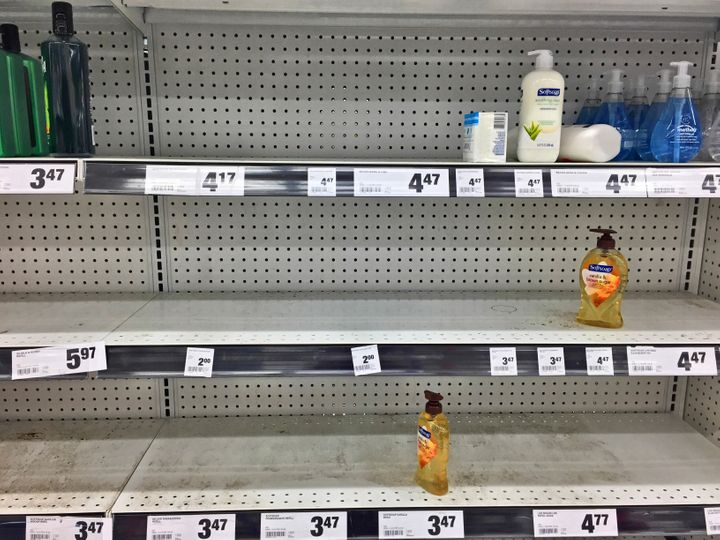 Nearly empty shelves containing hand soap at a grocery store on March 13 in Toronto.