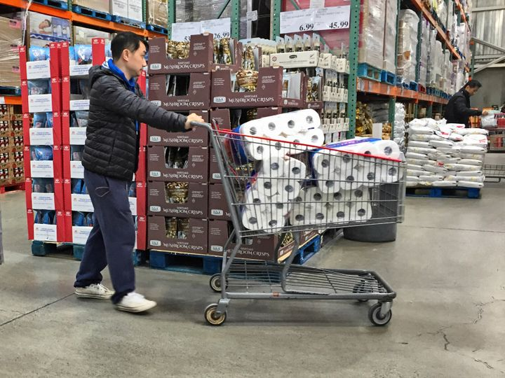 Man stocks up on toilet paper as Canadians purchase food and essential items in Markham, Ont. on March 7, 2020.