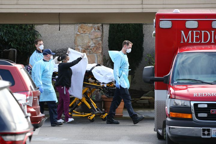 A patient is transferred to an ambulance at the Life Care Center in Kirkland, Washington. As of late last week, 26 residents