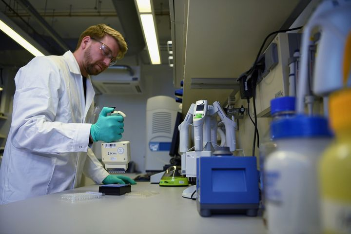 Employee Philipp Hoffmann, of German biopharmaceutical company CureVac, demonstrates research workflow on a vaccine for the coronavirus (COVID-19) disease at a laboratory in Tuebingen, Germany, March 12, 2020. (REUTERS/Andreas Gebert)