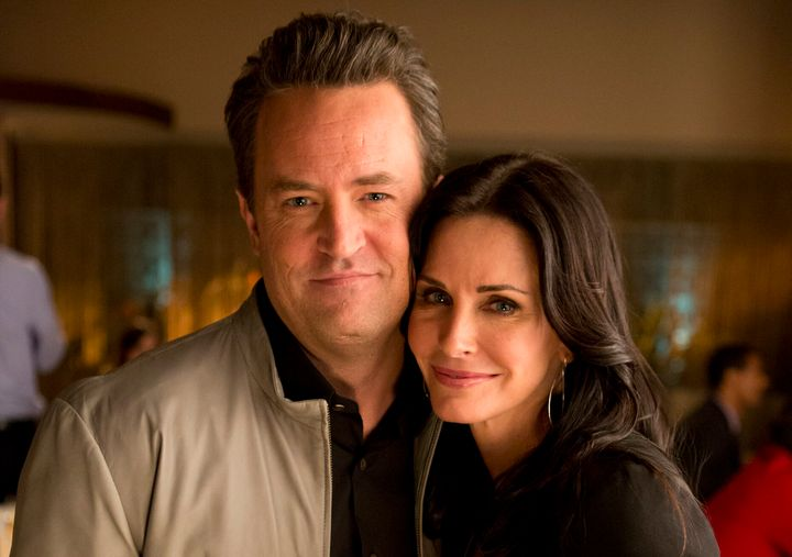 """Matthew Perry and Courteney Cox pictured together on the set of """"Go On."""""""
