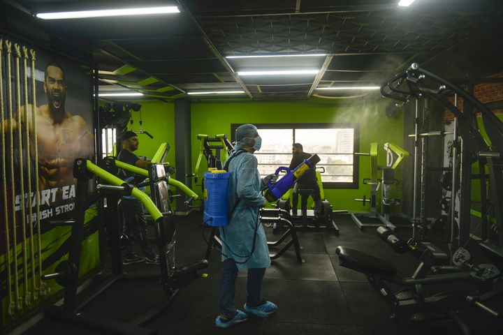 An official carries out disinfection work as a precaution against the coronavirus at a fitness centre in Gaza City.