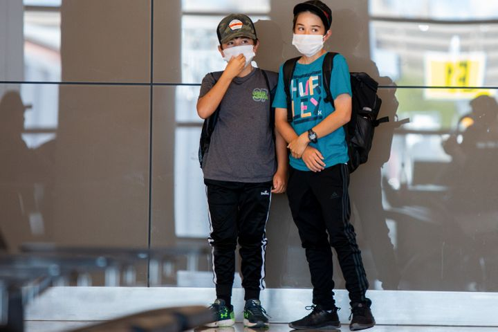 Kids play while wearing protective face masks in Phoenix, Arizona.