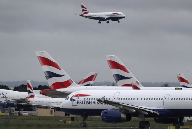 A British Airways plane comes in to land at Heathrow Airport in London as the airline announced that it has cancelled all flights to and from Italy which were scheduled today.