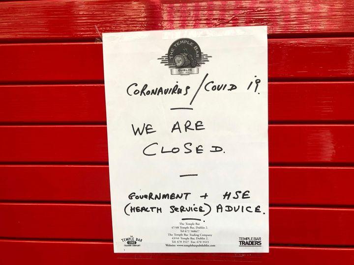 A sign on the door of The Temple Bar announces its closure amid coronavirus fears, in Dublin, Ireland, on Sunday.