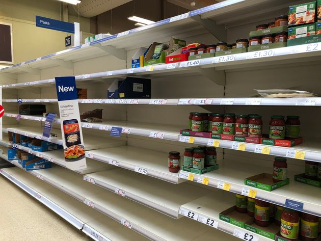 Shelves empty of pasta at Tesco in Camelon near Falkirk, as shoppers purchase supplies amid the coronavirus pandemic.