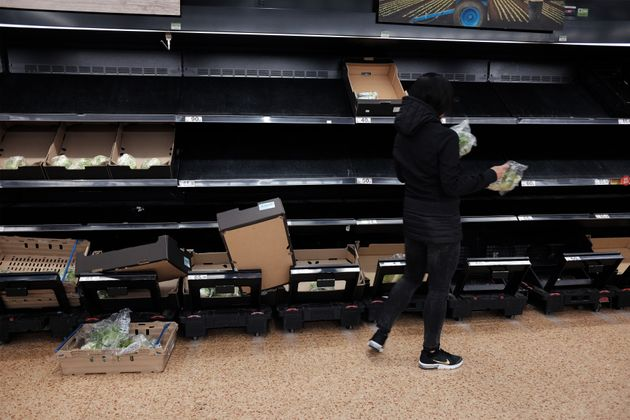 Empty shelves in the fruit and vegetable section of an Asda store in London.