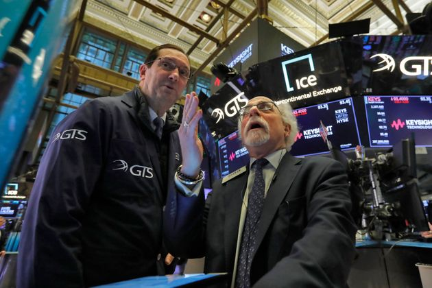 William O'Keefe, left, and Peter Tuchman work on the floor of the New York Stock Exchange, Tuesday, March...