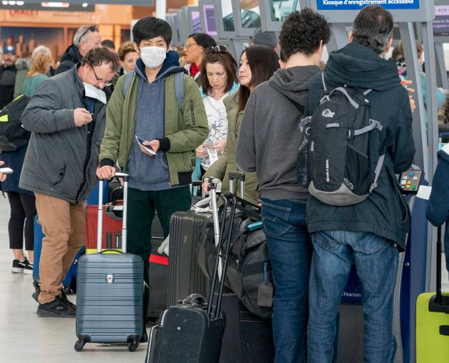 Passengers check in for their flights at Pearson Airport in Toronto on