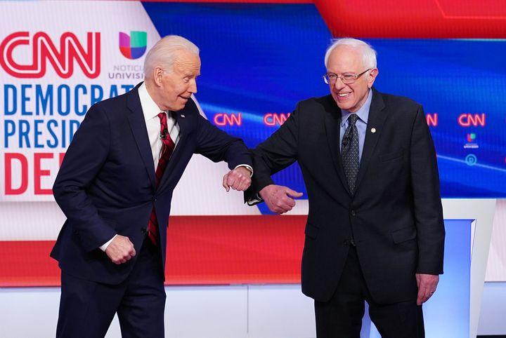 Democratic presidential hopefuls former Vice President Joe Biden and Sen. Bernie Sanders (I-Vt.) greet each other with an elb