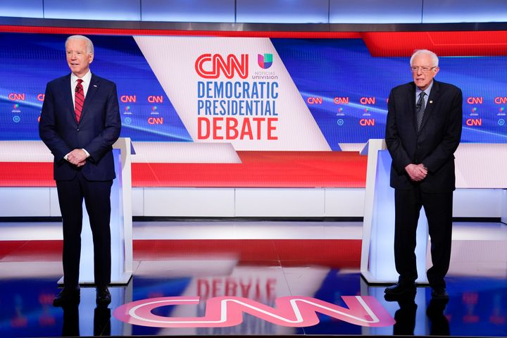 Former Vice President Joe Biden and Sen. Bernie Sanders (I-Vt.) on stage at the Democratic primary debate on Sunday. During t