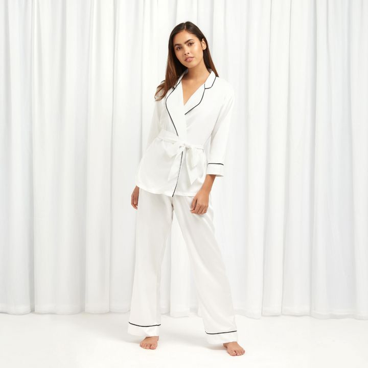 """<a href=""""https://fave.co/2wZE1DH"""" target=""""_blank"""" rel=""""noopener noreferrer"""">Wren Kimono and Trouser Set Ivory, Bluebella</a>, &pound;44"""