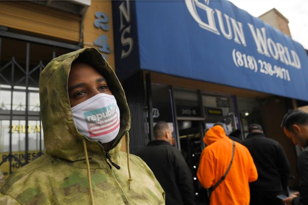 A gun store customer who gave his name only as John waits in line in Burbank, California, on