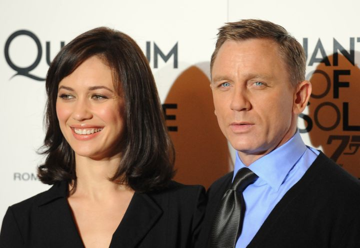 "Olga Kurylenko and Daniel Craig pose at a 2008 screening of ""Quantum of Solace"" in Rome."