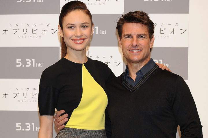 """Kurylenko and Tom Cruise at an """"Oblivion"""" press conference in Tokyo in 2013."""