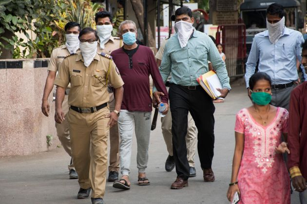People wear masks as protection from coronavirus at Kasturba Hospital, in Mumbai where Covid-19 suspects...