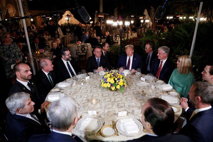 Trump hosts a working dinner with Brazilian President Jair Bolsonaro at the Mar-a-Lago resort in Palm Beach, Florida, on Marc