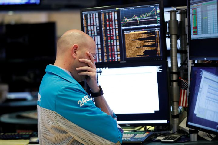 A trader reacts as he works on the floor of the New York Stock Exchange in New York City on March 11, 2020.