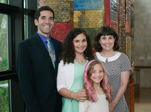 Debi Lewis with her husband, David, and daughters Ronni (back) and Sammi