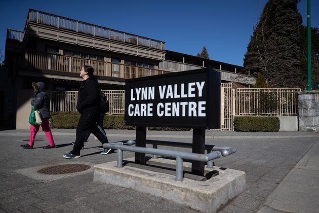 Workers arrive at the Lynn Valley Care Centre seniors facility in North Vancouver on March 14,
