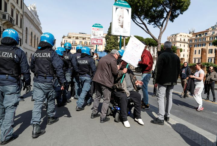 Police stormed a demonstration near the Ministry of Justice building in Rome as people protested the suspension of family vis