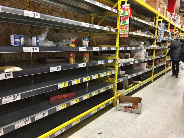 A grocery store with empty shelves in Toronto. As it becomes increasingly difficult to leave the house, community groups are stepping up to help care for the most vulnerable.