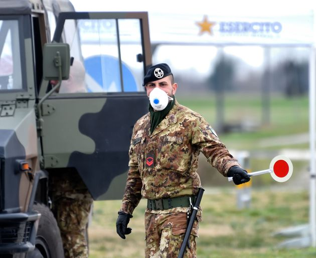 ITALY, February 27, 2020 -- An Italian Army soldier checks transit to and from the cordoned areas in...