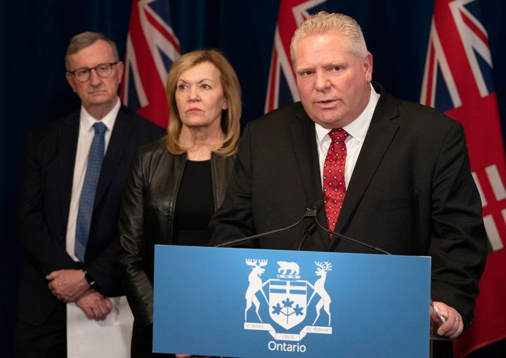 Ontario Premier Doug Ford answers questions as Ontario Health Minister Christine Elliott and Ontario Chief Medical Officer of Health Dr. David Williams, left, listen in during a news conference in Toronto on March 16, 2020.