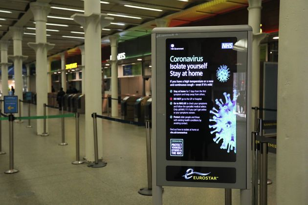 A coronavirus information sign at King's Cross railway station in