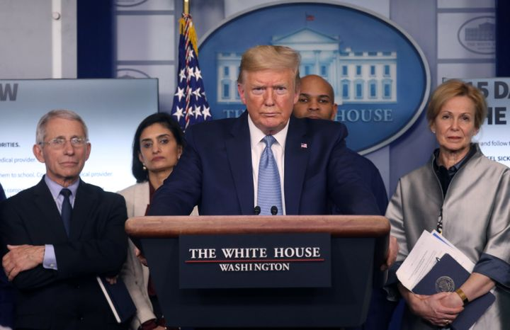 President Donald Trump holds a news briefing Monday on the coronavirus outbreak while accompanied by members of the coronavirus task force at the White House