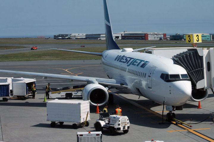 A WestJet airplane is shown at the St. John's International Airport on July 31, 2019.