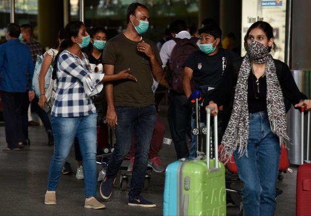 Airline passengers wearing masks at Mumbai airport on