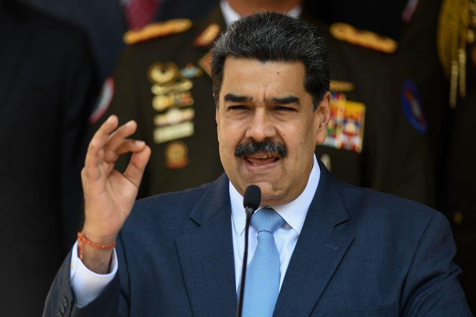 Venezuelan President Nicolas Maduro gives a press conference at the Miraflores Presidential Palace in Caracas, Venezuela, Thu