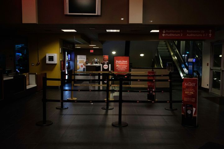 An empty AMC movie theater lobby in New York on Monday night.