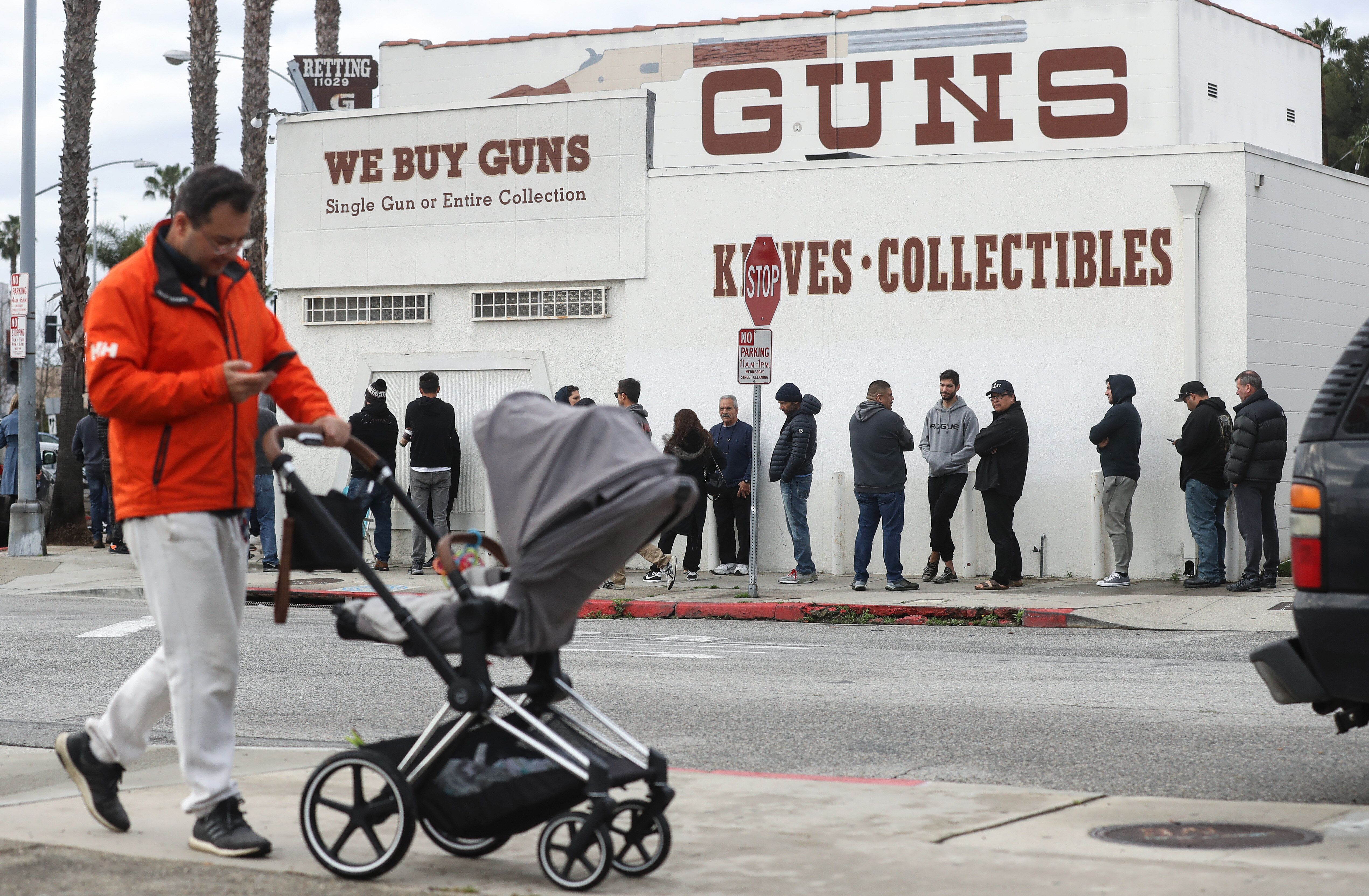 People stand in line outside the Martin B. Retting, Inc. guns store on March 15, 2020 in Culver City, California.