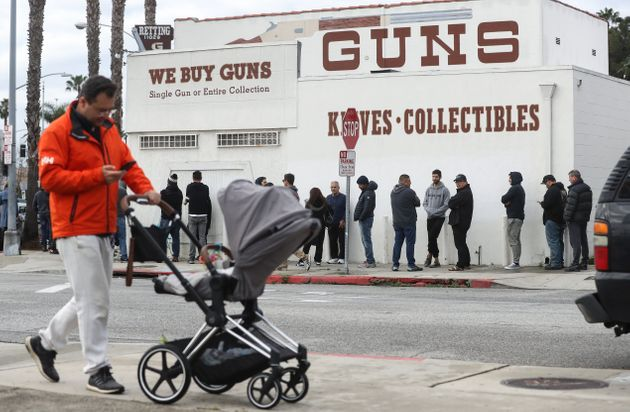 People stand in line outside the Martin B. Retting, Inc. guns store in Culver City, California, on