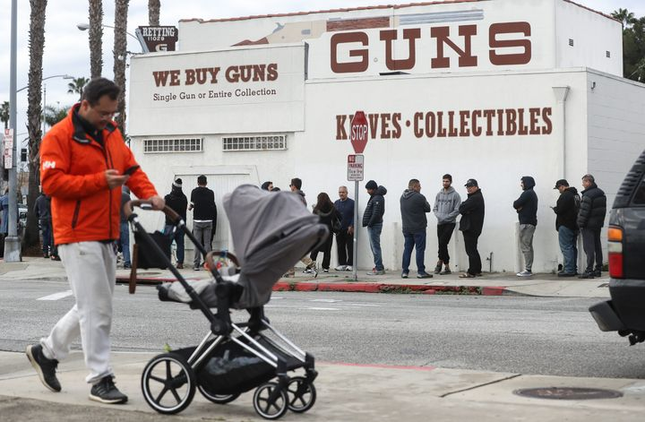 People stand in line outside the Martin B. Retting, Inc. guns store in Culver City, California, on Sunday.