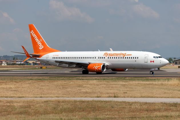 A Sunwing Airlines Boeing 737-800 landing at Verona Villafranca airport in July
