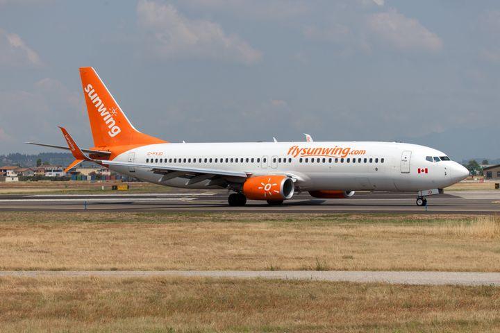 A Sunwing Airlines Boeing 737-800 landing at Verona Villafranca airport in July 2019.