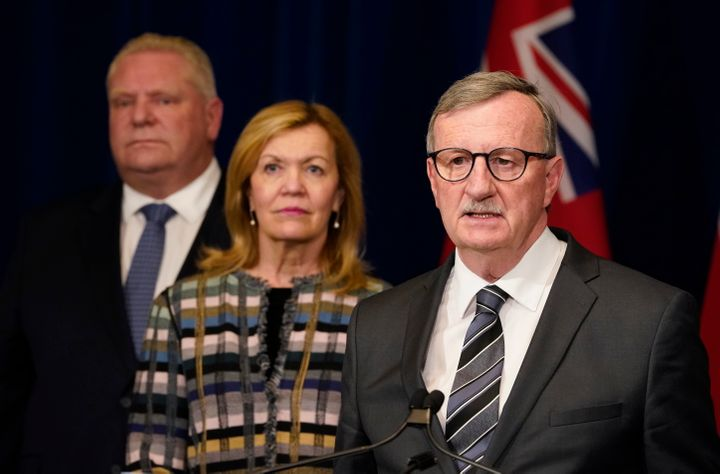 Ontario's chief medical officer Dr. David Williams speaks to the media with Health Minister Christine Elliott and Premier Doug Ford in the background in Toronto on Tuesday.