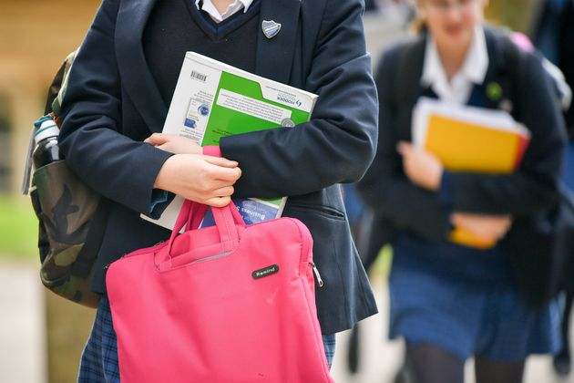 School pupils holding bags and