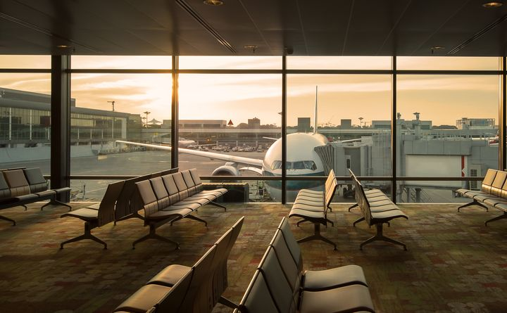 In this stock photo, an airplane can be seen through the window of an empty airport terminal lounge.The world's major airlines will face bankruptcy within a few months if governments don't step up immediately with aid, industry groups are warning.