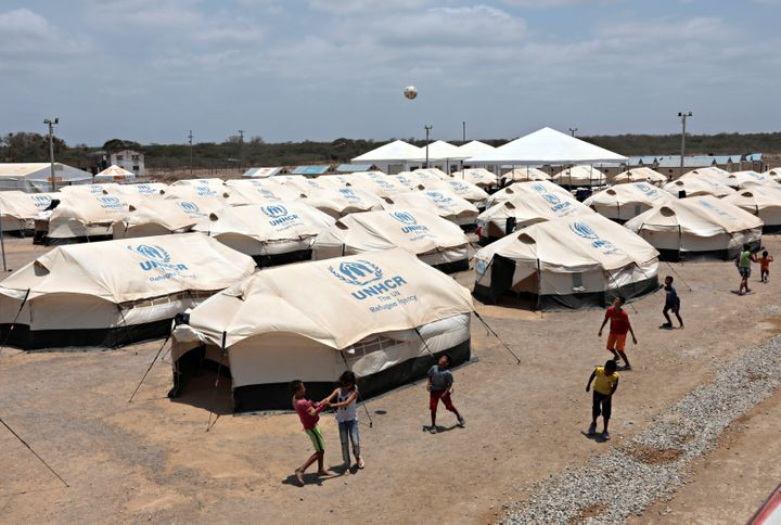Venezuelan migrant children play soccer in a camp run by the UN refugee agency UNHCR in Maicao, Colombia.