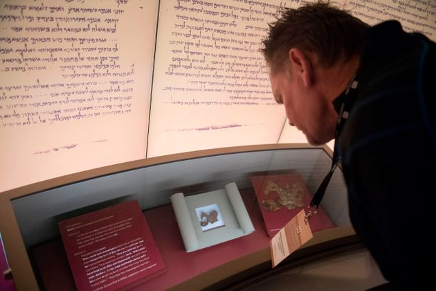 A visitor looks at an exhibit on the Dead Sea scrolls at the Museum of the Bible in Washington, D.C.,...