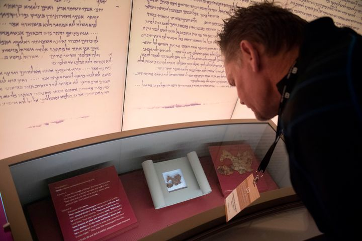 A visitor looks at an exhibit on the Dead Sea scrolls at the Museum of the Bible in Washington, D.C., in 2017. An examination
