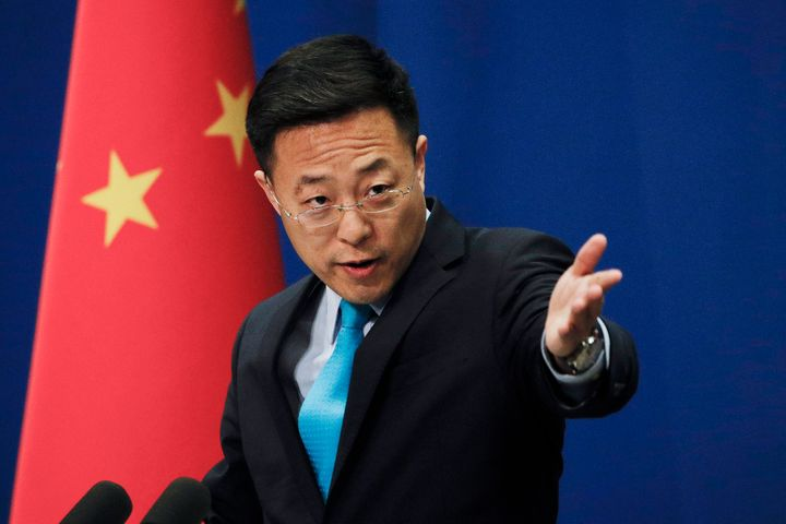 Chinese Foreign Ministry new spokesman Zhao Lijian gestures as he speaks during a daily briefing at the Ministry of Foreign A