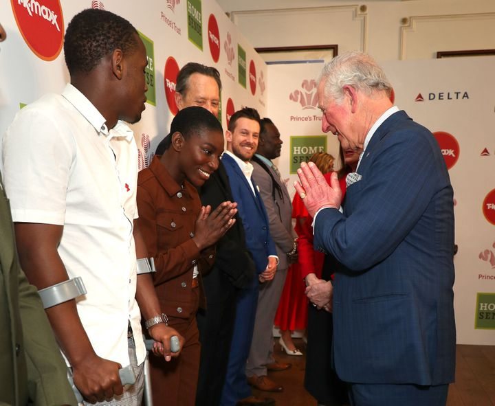 Charles greets Michaela Coel (centre) as he attends the Prince's Trust And TK Maxx & Homesense Awards at London Palladium
