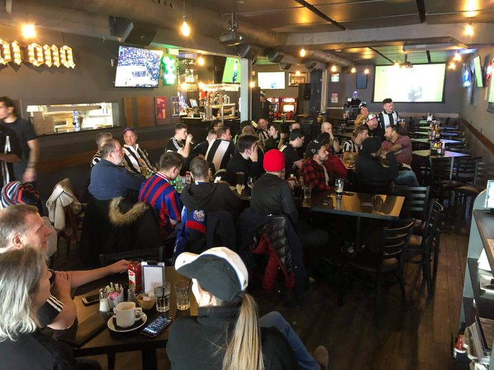Sports fans fill 817 Sports Bar and Grill in Toronto.