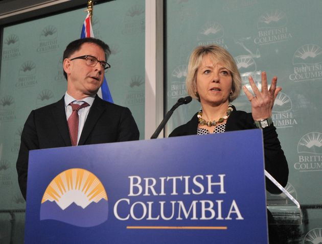 British Columbia Minister of Health Adrian Dix and Dr. Bonnie Henry, provincial health officer, speak...